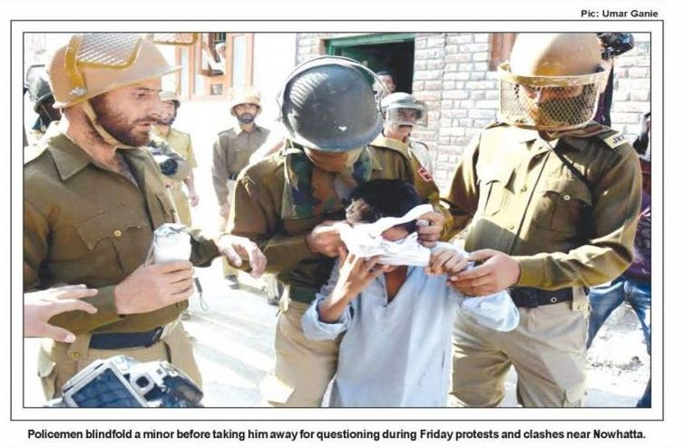 9 years old child, arresting and blindfolding him, misbehaving with the media persons and threatening to shoot them
